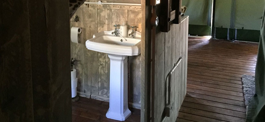 woody safari tent bathroom